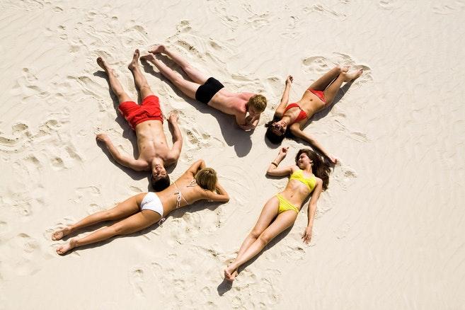 People sunbathing in the sand